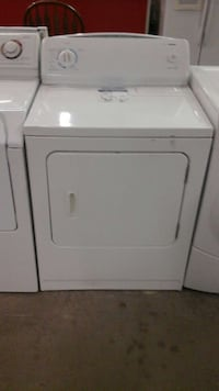 White Kenmore Electric Dryer with a Warranty