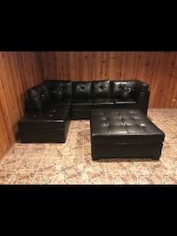 BRAND NEW BLACK LEATHER SECTIONAL W/ OTTOMAN  Des Plaines