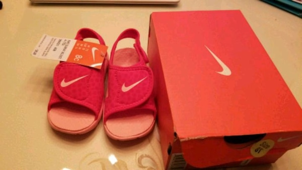 pair of red Nike shoes(size 8T)