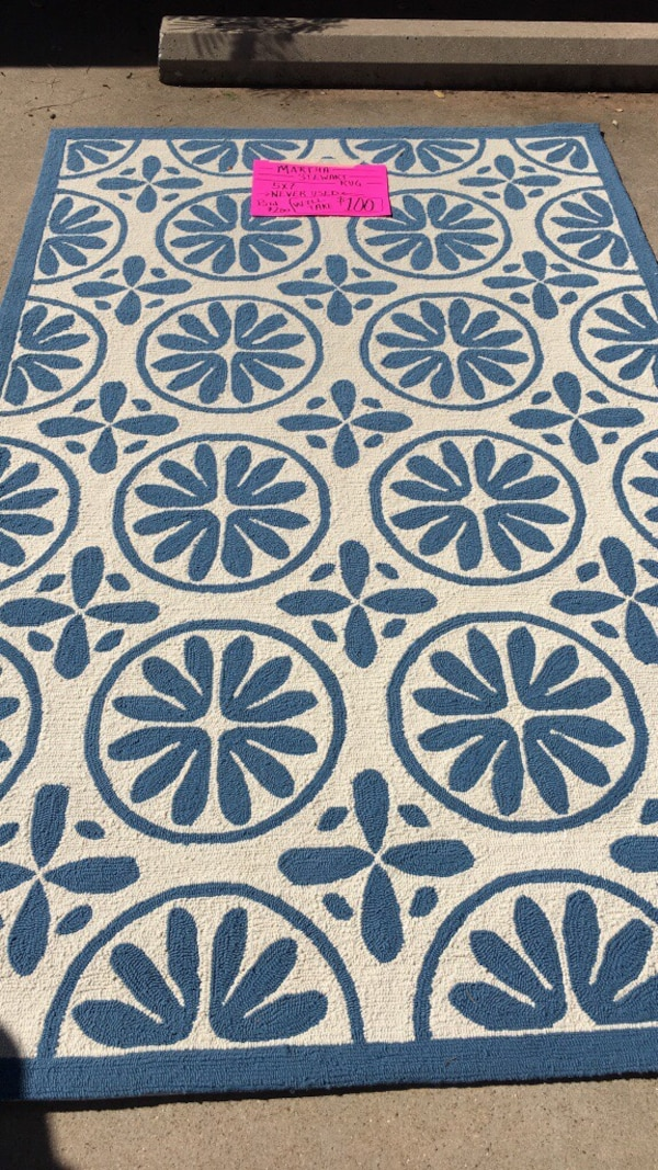 white and blue floral rug