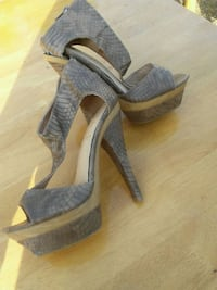 pair of gray open-toe ankle strap wedge sandals