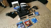 black Sony PS4 with controllers and game cases Camberwell, SE5