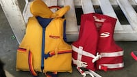 Two kids life jackets, yellow one is 30-60lb and red is 30-50lb. $10 each