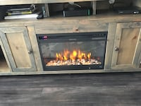 brown wooden framed electric fireplace 28 km