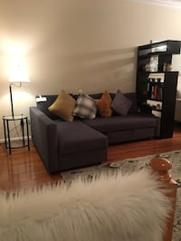 Sofa bed IKEA L shape with two cushions and rug- used only for 4 months