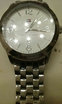 round silver-colored Tommy Hilfiger analog watch with link bracelet