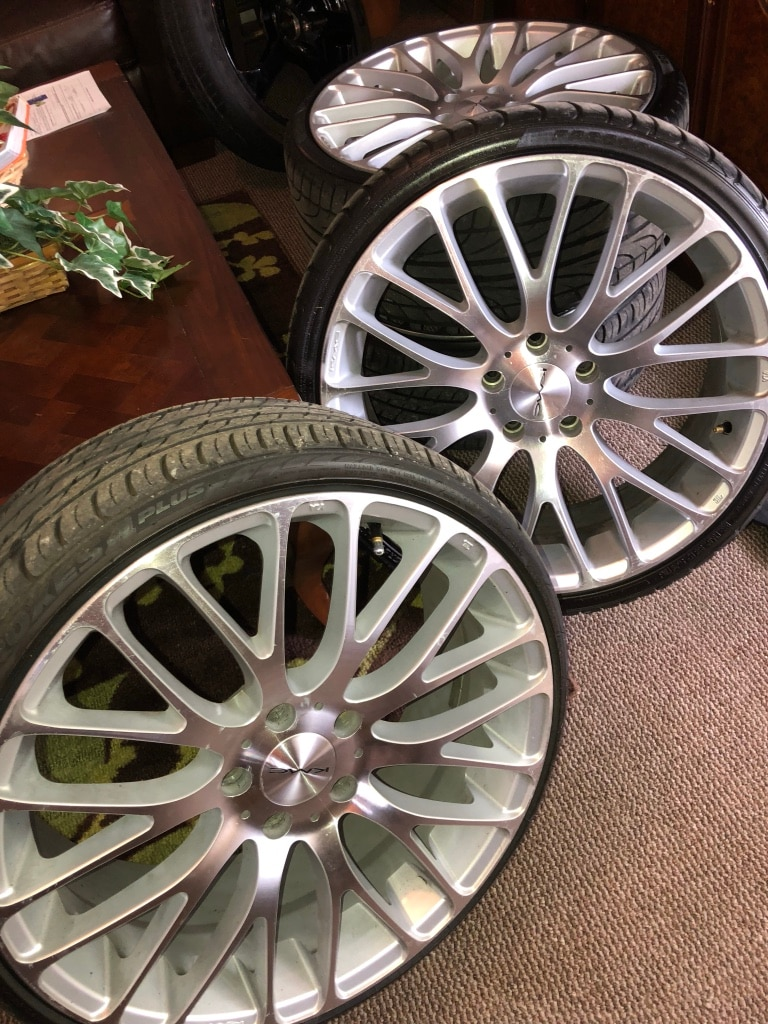 Photo 20 inch KMC wheels and low pro tires. Retail 1450$