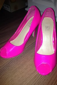 Pair of pink leather peep-toe heeled shoes