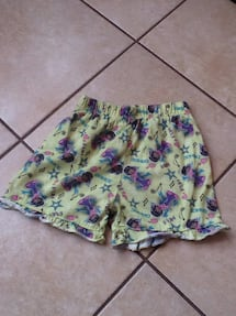 white, pink, and blue floral shorts