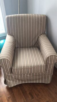 Brown and white striped sofa chair