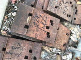 Railroad plates and spikes