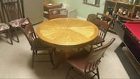"42"" Oak table and 4 wood chairs"