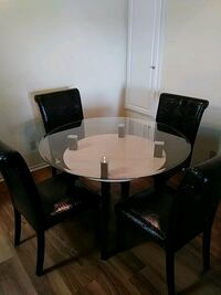 round glass top table with four chairs dining set Oceanside, 92056
