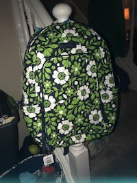 black, green, and white floral backpack