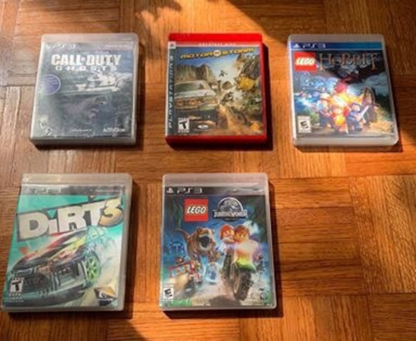 PS3 with 2 controllers and 11 games cb66525f-2511-484e-bbbd-2cefdf51c986