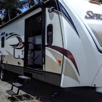 Are you thinking about building your own house? This is a great to live in as you build. Do you like to travel? Enjoy this home away from home. White and grey camper trailer Sanford, 32771