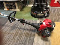 Red and black gas string trimmer