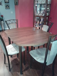 Brown table with extension 4 chairs velour seats Montreal, H8N 2S5