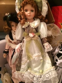 two female dolls in white and green dresses 555 km