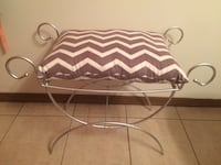 white and black zebra print padded chair