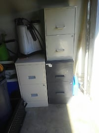 two gray and one black file cabinets