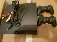 black Sony PS3 slim console with two controllers Calgary, T3K 6E8