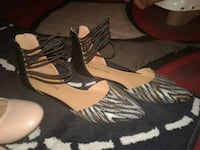 pair of black-and-brown wedge sandals Seattle, 98106