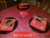 three square red ceramic plates and saucer and cho