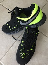 Pair of black-and-green nike running shoes Brossard, J4X 2Z1
