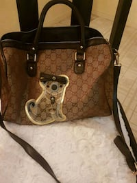Gorgeous Gucci 2 way bag with Gucci dog tag Whitby, L1N 8X2