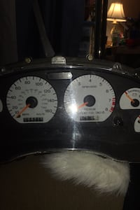 1998 Mustang Cobra SVT instrument cluster with bezel and housing
