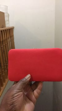 red and black leather wallet