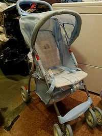Blue cosco baby stroller with basket very good con