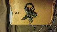Dragon necklace/tail is a knife Des Moines, 50317