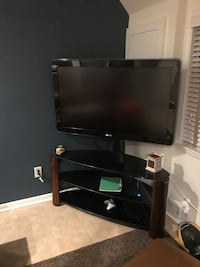 """60"""" HD TV with Mounted Entertainment Stand Reston, 20191"""