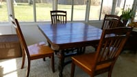 Antique brown wooden table with four chairs di