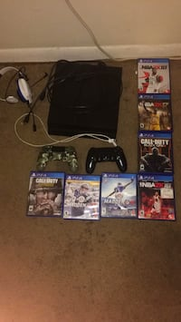 black Sony PS4 console with controller and game cases Charlotte, 28208