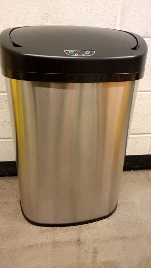 stainless steel and black trash can