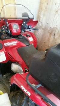 red and black Honda ATV Longueuil, J4K 2W6