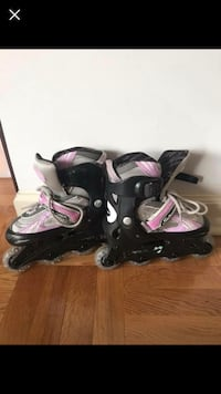 pair of black-and-pink inline skates 38 km