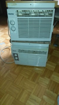 two white window-type air conditioner