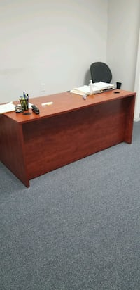 Brown wooden desk 815 mi