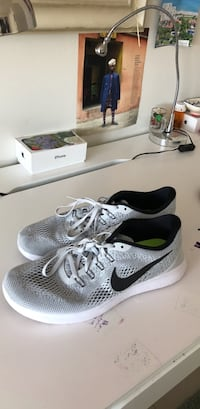 pair of gray Nike running shoes Fort Lauderdale, 33301
