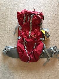 red and gray backpack mountain hardwear