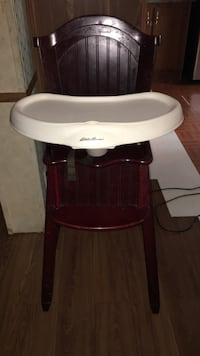 Baby's brown and white high chair