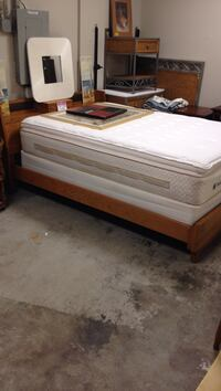 Full size Brown wooden bed frame with white mattress Broadview Heights, 44147
