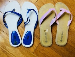 Pair of white-and-blue flip flops