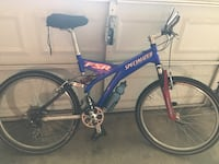 Blue and black full-suspension mountain bike