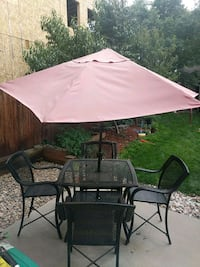 Patio furniture.  Table set with 4 chairs