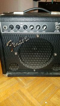 black and gray Fender guitar amplifier 548 km